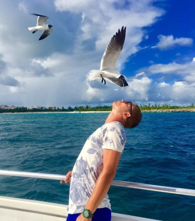 Birds eating from mouth during Catamaran trip